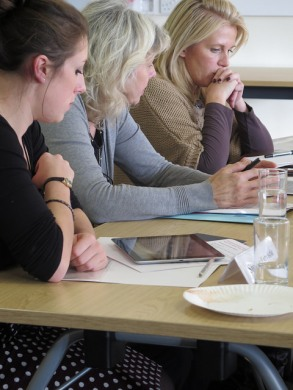 Three participants in discussion at the event in Swansea.