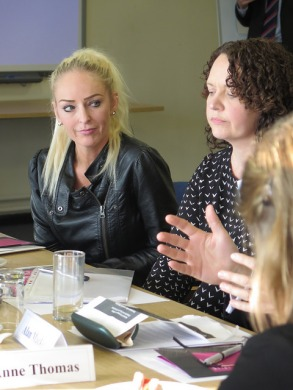 Two participants in discussion at the event in Swansea.