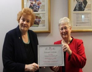 The Presiding Officer, Dame Rosemary Butler, and Sandy Mewies AM, holding the National Autistic Society Autism Access Award