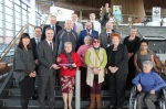 A photograph of people celebrating the Assembly receiving the National Autistic Society's Access Award