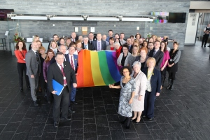 Photograph of Assembly LGBT staff and Allies holding the rainbow flag for LGBT History Month