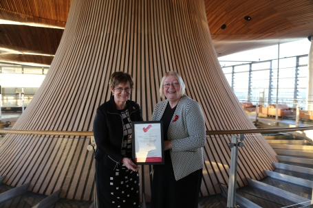 • Photo of Joyce Watson, AM and Ann Jones, Deputy Presiding Officer with the National Autistic Society Access Award certificate.